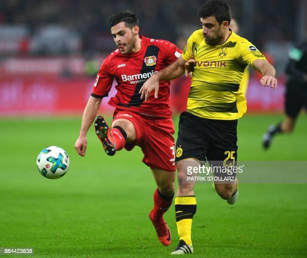 Leverkusen's striker Kevin Volland vies with Dortmund's Greek defender Sokratis during the German First division Bundesliga football match Bayer...