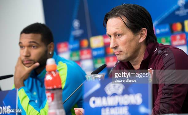 Leverkusen's Trainer Roger Schmidt  and player Jonathan Tah speak during a press conference in the BayArena in Leverkusen Germany 17 October 2016...