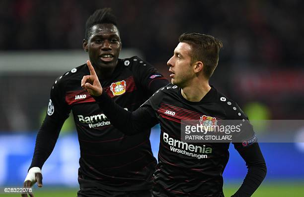 Leverkusen's Ukrainian midfielder Vladlen Yurchenko celebrates scoring the opening goal with Leverkusen's defender Danny Da Costa during the UEFA...