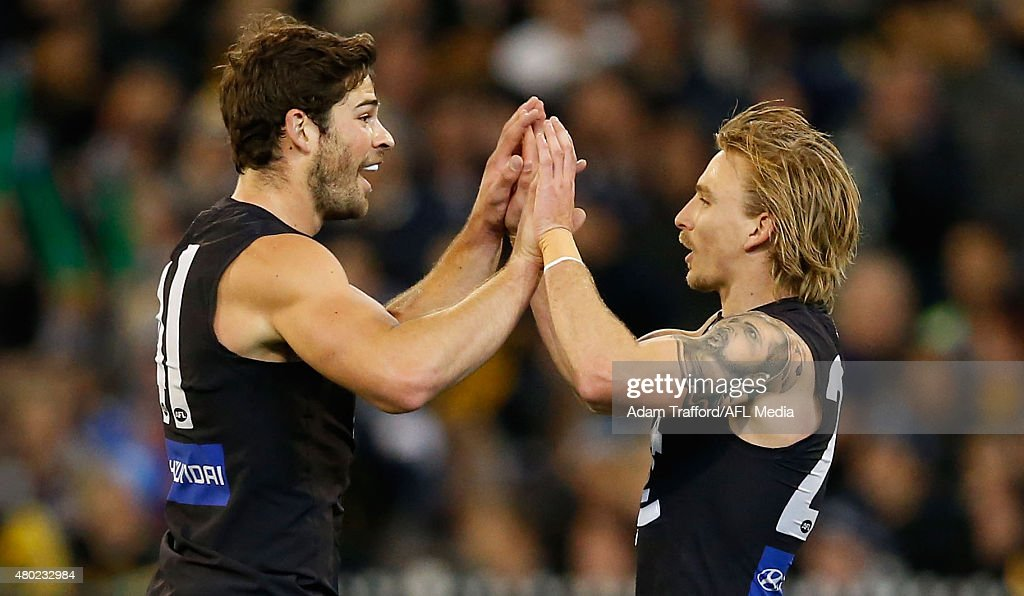 Levi Casboult (left) and Dennis Armfield of the Blues celebrate a goal during the 2015 AFL round 15 match between the Richmond Tigers and the Carlton Blues at the Melbourne Cricket Ground, Melbourne, Australia on July 10, 2015.