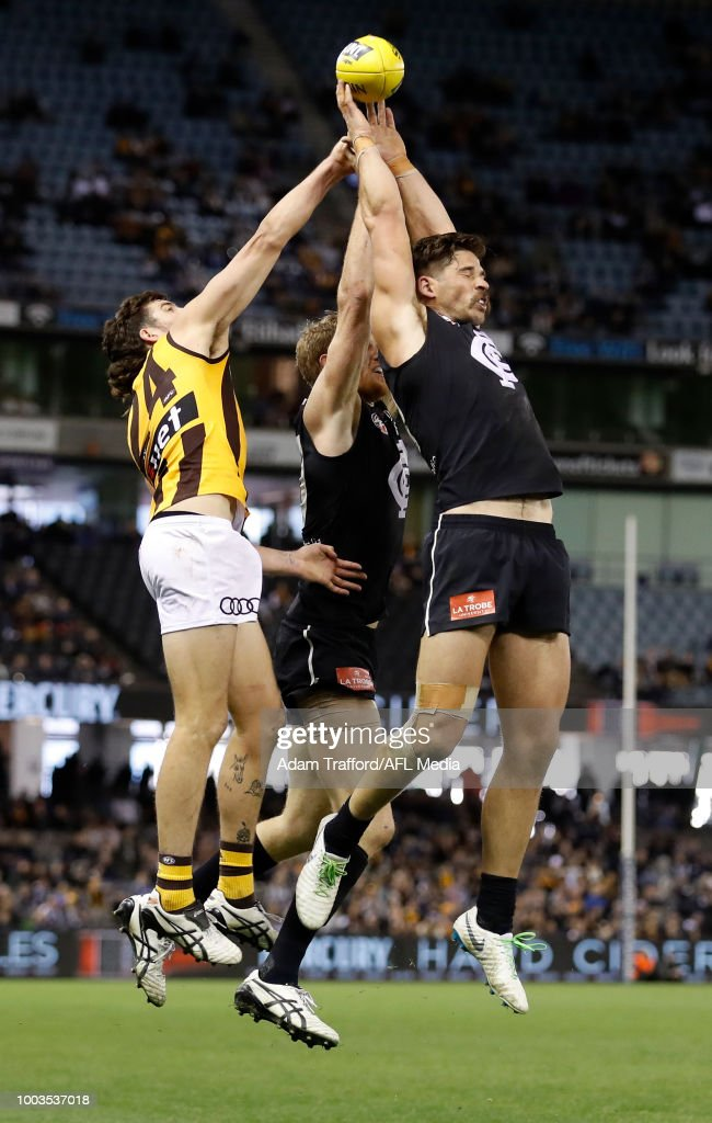 Levi Casboult of the Blues and Ben Stratton of the Hawks compete for the ball during the 2018 AFL round 18 match between the Carlton Blues and the Hawthorn Hawks at Etihad Stadium on July 22, 2018 in Melbourne, Australia.
