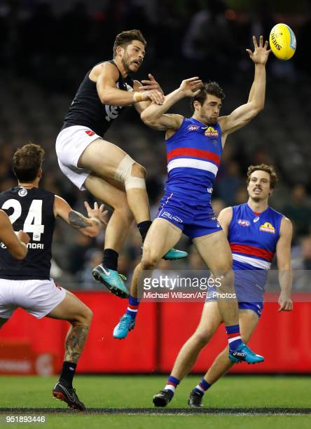 Levi Casboult of the Blues and Easton Wood of the Bulldogs compete for the ball during the 2018 AFL round six match between the Western Bulldogs and...