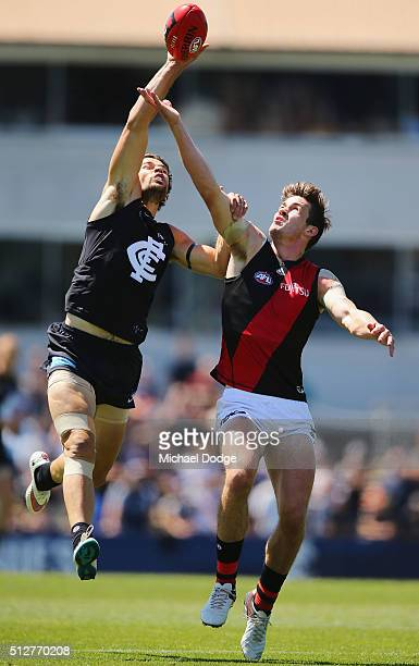 Levi Casboult of the Blues and Michael Hartley of the Bombers compete for the ball during the 2016 AFL NAB Challenge match between Carlton and...