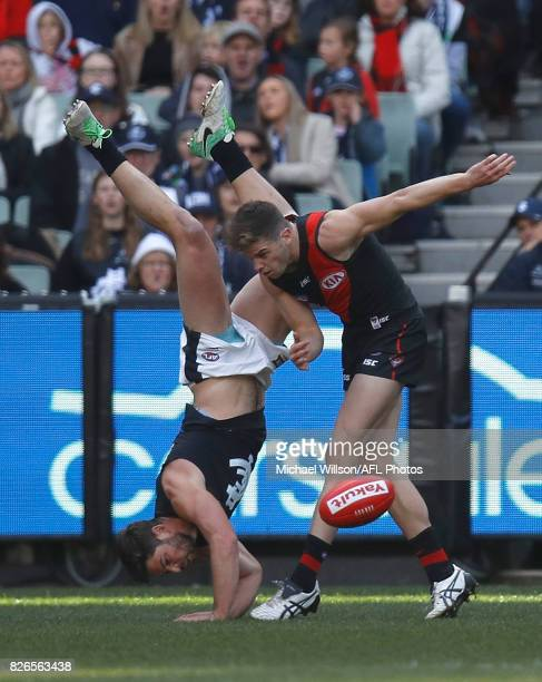 Levi Casboult of the Blues and Patrick Ambrose of the Bombers compete for the ball during the 2017 AFL round 20 match between the Essendon Bombers...