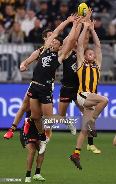 Levi Casboult of the Blues and Sam Frost of the Hawks contest for a mark during the round nine AFL match between the Carlton Blues and the Hawthorn...