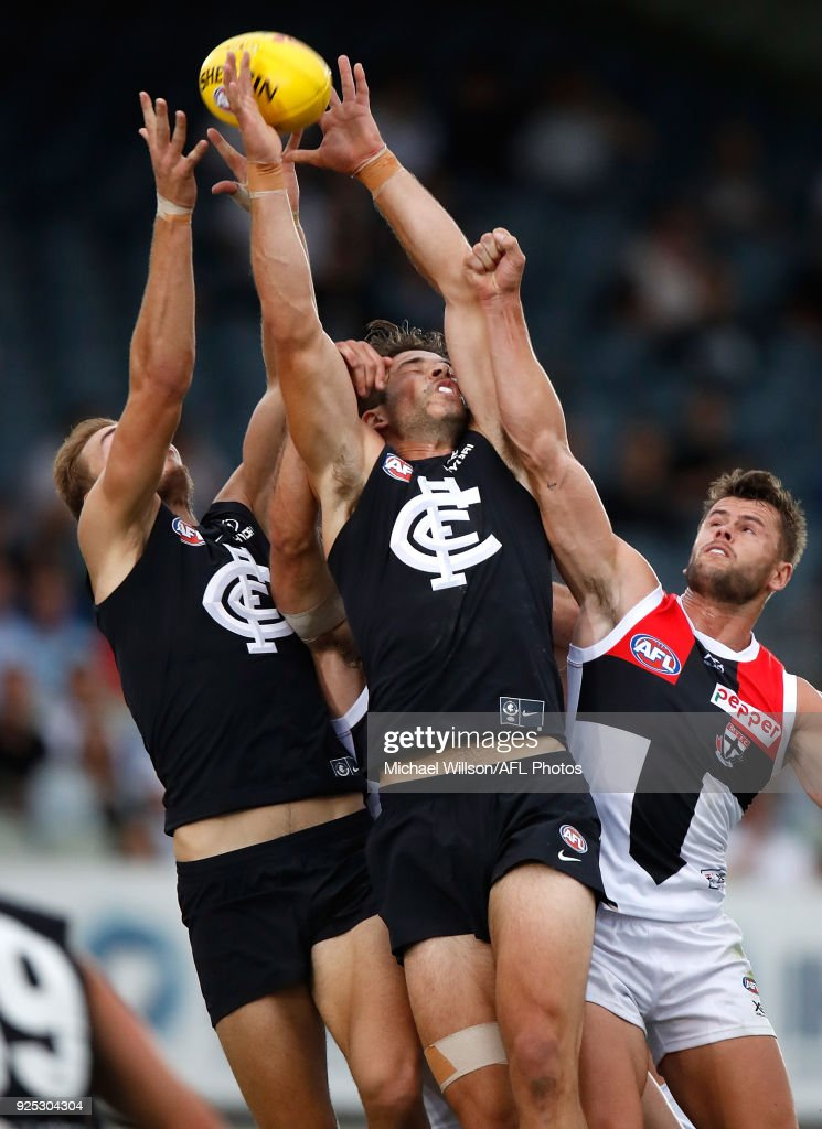 Levi Casboult of the Blues and teammate Harry McKay (left) compete for the ball against Maverick Weller of the Saints during the AFL 2018 JLT Community Series match between the Carlton Blues and the St Kilda Saints at Ikon Park on February 28, 2018 in Melbourne, Australia.