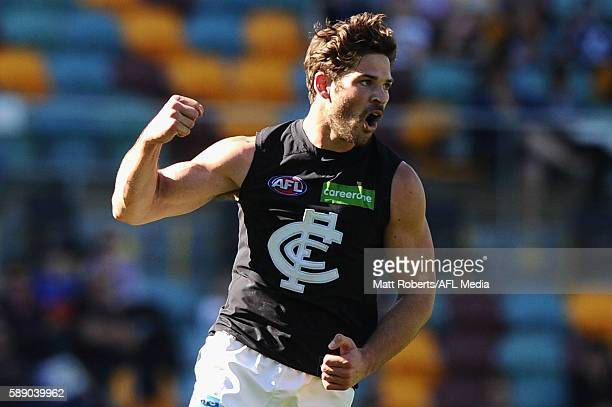 Levi Casboult of the Blues celebrates kicking a goal during the round 21 AFL match between the Brisbane Lions and the Carlton Blues at The Gabba on...