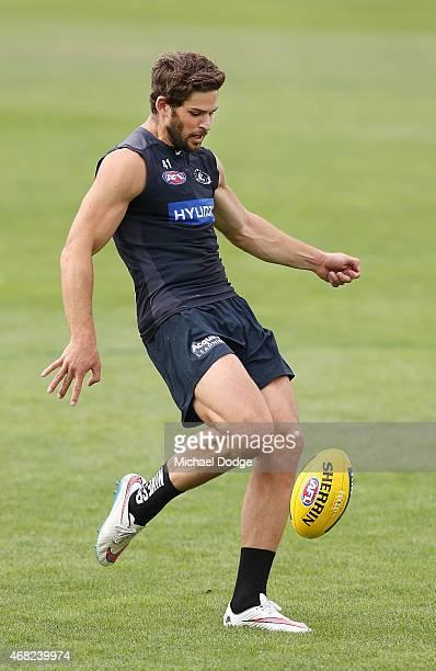 Levi Casboult of the Blues kicks the ball during a Carlton Blues AFL training session at Ikon Park on April 1 2015 in Melbourne Australia