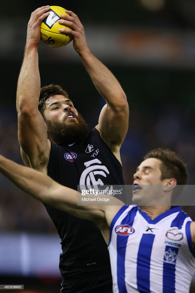 Levi Casboult of the Blues marks the ball against Ryan Bastinac of the Kangaroos during the round 18 AFL match between the Carlton Blues and the North Melbourne Kangaroos at Etihad Stadium on July 18, 2014 in Melbourne, Australia.