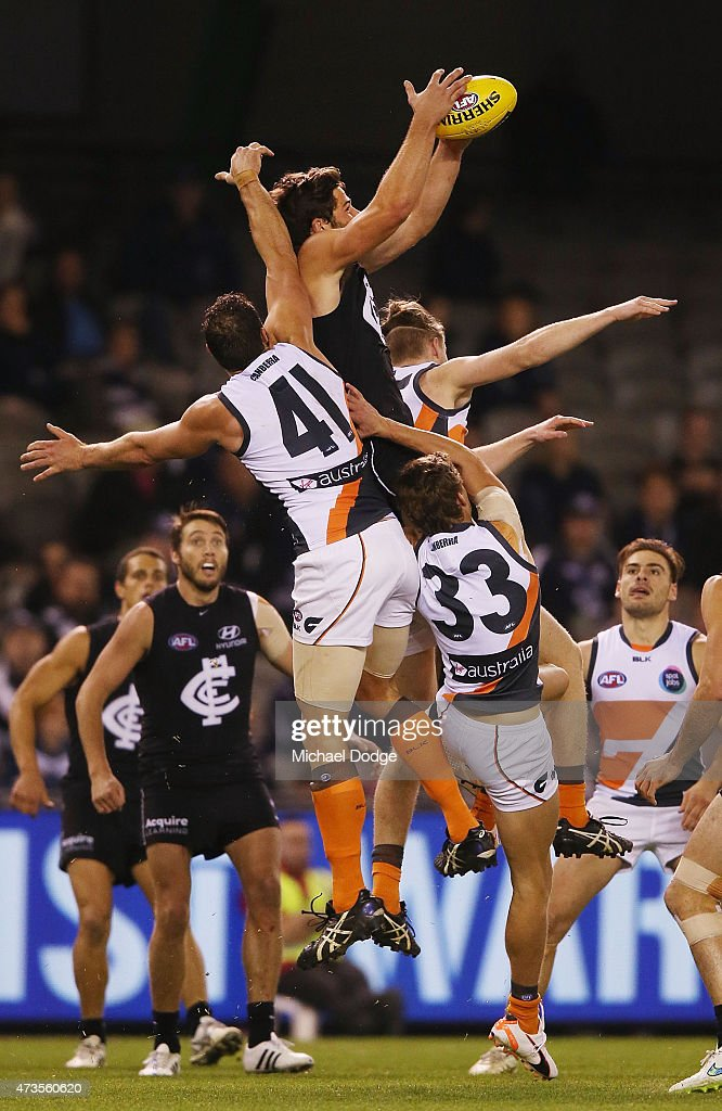 Levi Casboult of the Blues marks the ball against Shane Mumford of the Giants during the round seven AFL match between the Carlton Blues and the Greater Western Sydney Giants at Etihad Stadium on May 16, 2015 in Melbourne, Australia.