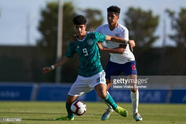 Levi Colwill of U17 England competes for the ball with Emrehan Gedikli of U17 Germany during the International Friendly match between U17 England and...