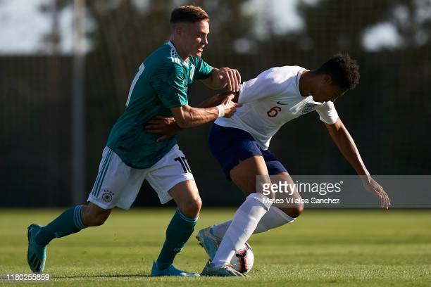 Levi Colwill of U17 England competes for the ball with Florian Wirtz of U17 Germany during the International Friendly match between U17 England and...