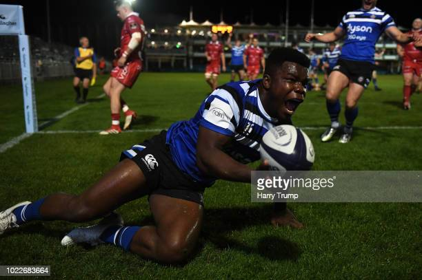 Levi Davies of Bath Rugby celebrates after scoring a try during the Pre Season Friendly match between Bath and Scarlets at the Recreation Ground on...