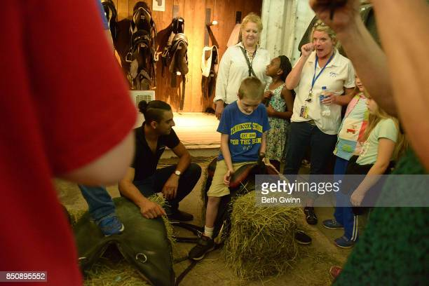 Levi Dykes sits on a saddle to give him the experience of what that feels like on September 21 2017 in Nashville Tennessee