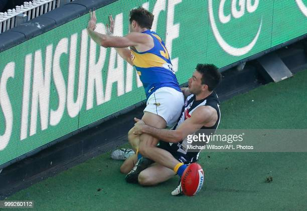 Levi Greenwood of the Magpies takes a high mark over Jake Waterman of the Eagles during the 2018 AFL round 17 match between the Collingwood Magpies...