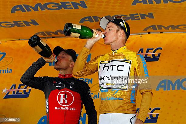 Levi Leipheimer of Team Radio Shack and Michael Rogers of Australia riding for HTCColumbia drink champagne as they celebrate on the podium after the...