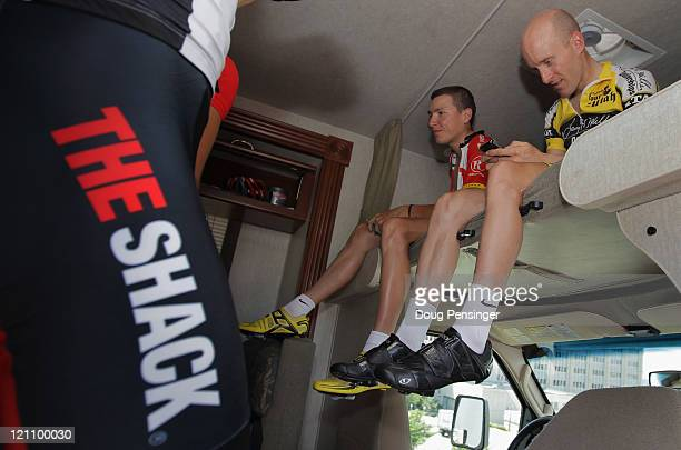 Levi Leipheimer of the USA and Janez Brajkovic of Slovenia riding for Team Radioshack relax in the team bus prior to the start of stage four of the...
