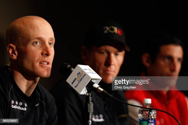 Levi Leipheimer speaks as teammate Lance Armstrong of Team Radio Shack listens with George Hincapie of BMC Racing during a during a press conference...