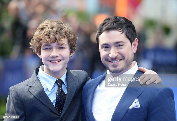 Levi Miller and writer Jason Fuchs attend the World Premiere of Pan at Odeon Leicester Square on September 20 2015 in London England