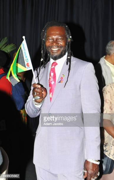 Levi Roots holds a Jamaican flag as he attends the Jamaica 50 Flag Raising Ceremony at Jamaica House at O2 Arena on August 6 2012 in London England