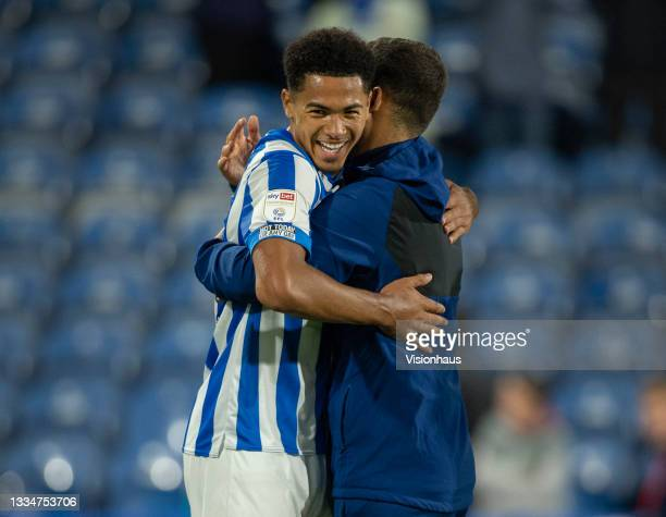 Levi Samuels Colwill of Huddersfield Town celebrates with assistant coach Narcís Pèlach after winning the Sky Bet Championship match between...