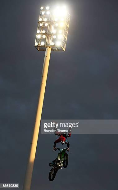 Levi Sherwood of New Zealand performs a scorpion during the Australasian Freestyle Motorcross Championship Super X at Parramatta Stadium on November...
