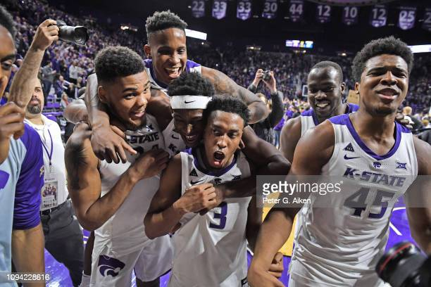 Levi Stockard III Austin Trice Kamau Stokes and Nigel Shadd of the Kansas State Wildcats celebrate after defeating the Kansas Jayhawks on February 5...