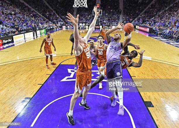 Levi Stockard III of the Kansas State Wildcats puts up a shot against Will Baker of the Texas Longhorns during the first half at Bramlage Coliseum on...