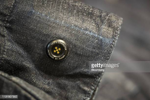 A Levi Strauss Co Commuter Jacquard by Google button is attached to a jacket inside the company's flagship store in San Francisco California US on...