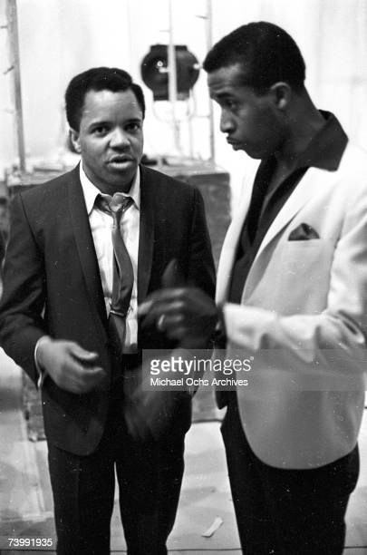 Levi Stubbs of the RB vocal group The Four Tops chats with the head of Motown Berry Gordy on the set of TV show Hullabaloo in 1965 in New York City...