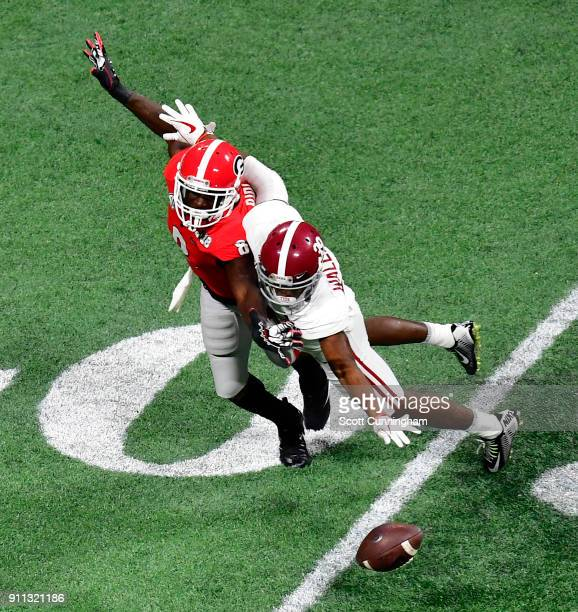 Levi Wallace of the Alabama Crimson Tide breaks up a pass against Riley Ridley of the Georgia Bulldogs in the CFP National Championship presented by...