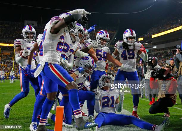 Levi Wallace of the Buffalo Bills celebrates with his defensive teammates after catching an interception in the fourth quarter against the Pittsburgh...