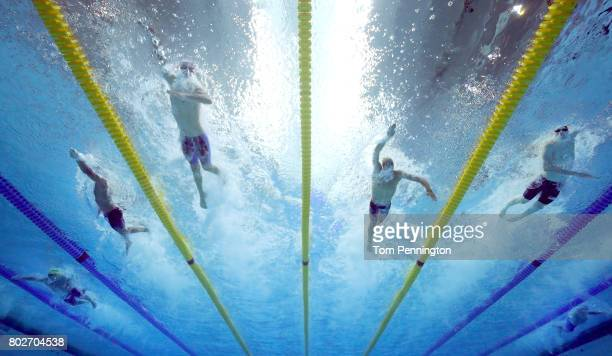 Levin Lintherland, Maxime Rooney, Clark Smith, Conor Dwyer, Zane Grothe and True Sweetser compete in a Men's 200 LC Meter Freestyle heat race during...