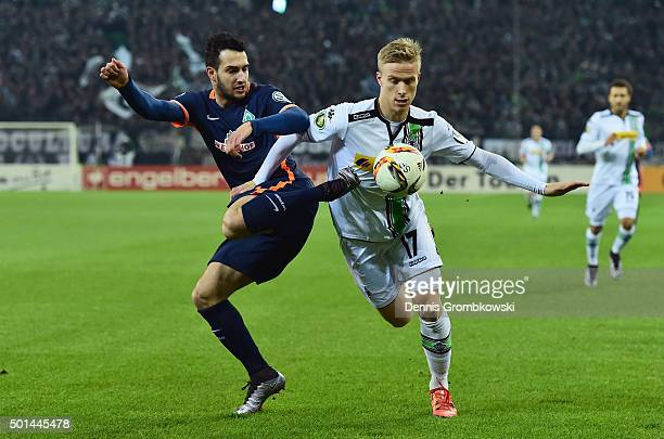 Levin Mete Oeztunali of Werder Bremen challenges Oscar Wendt of Borussia Moenchengladbach during the DFB Cup Round of 16 match between Borussia...