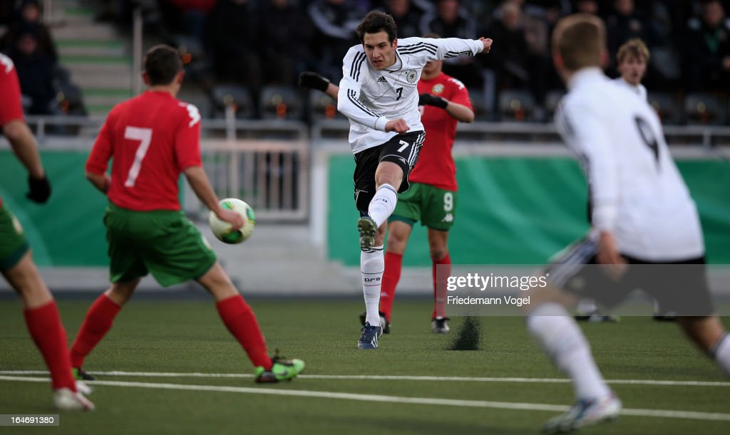 Levin Mete Oezuntali of Germany runs with the ball during the UEFA Under17 Elite Round match between Germany and Bulgaria at Toennies-Arena on March 26, 2013 in Rheda-Wiedenbruck, Germany.