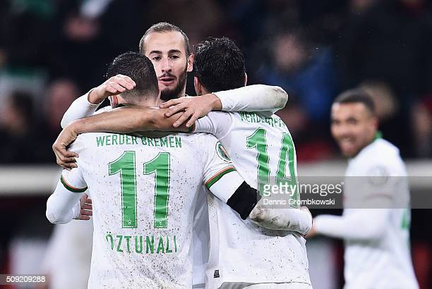 Levin Oeztunali Alejandro Galvez and Claudio Pizarro of Werder Bremen celebrate as Florian Grillitsch of Werder Bremen scores their third goal during...