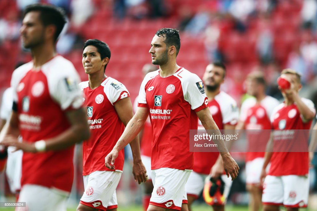 Levin Oeztunali (C) and team mates of Mainz react after the Bundesliga match between 1. FSV Mainz 05 and Hannover 96 at Opel Arena on August 19, 2017 in Mainz, Germany.