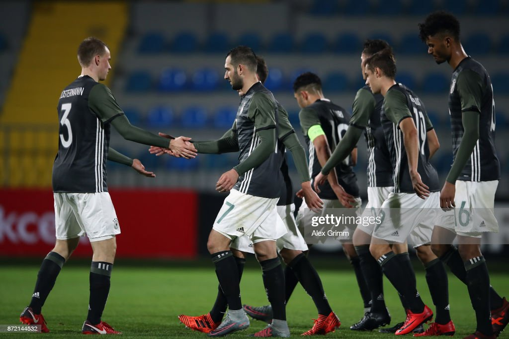 Levin Oeztunali of Germany celebrates his team's seventh goal with team mates during the UEFA Under21 Euro 2019 Qualifier match between Azerbaijan U21 and Germany U21 at Dalga Arena on November 9, 2017 in Baku, Azerbaijan.