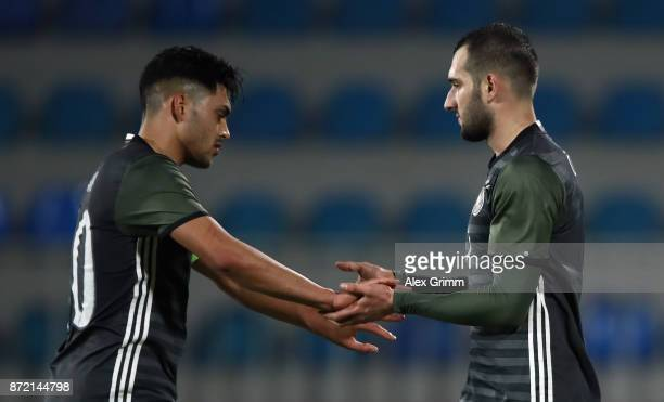 Levin Oeztunali of Germany celebrates his team's seventh goal with team mate Nadiem Amiri during the UEFA Under21 Euro 2019 Qualifier match between...