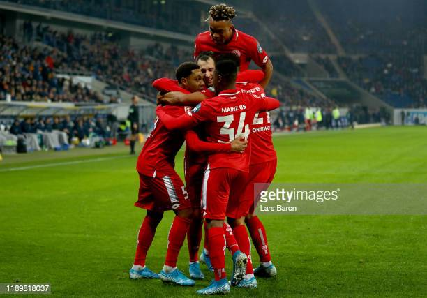 Levin Oeztunali of Mainz celebrates with team mates during the Bundesliga match between TSG 1899 Hoffenheim and 1 FSV Mainz 05 at PreZeroArena on...