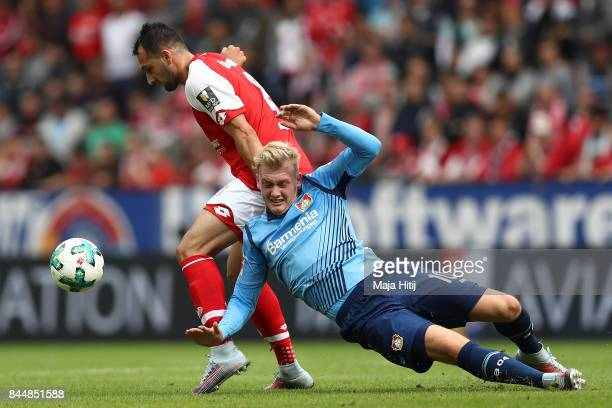 Levin Oeztunali of Mainz fights for the ball with Julian Brandt of Bayer Leverkusen during the Bundesliga match between 1 FSV Mainz 05 and Bayer 04...