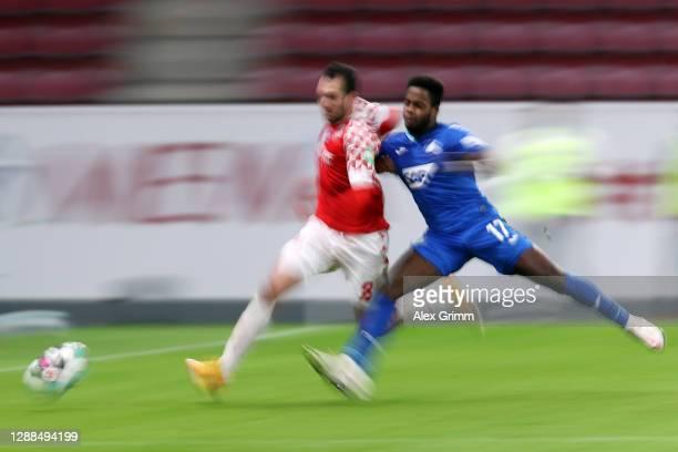 Levin Oeztunali of Mainz is challenged by Ryan Sessegnon of Hoffenheim during the Bundesliga match between 1. FSV Mainz 05 and TSG Hoffenheim at Opel...