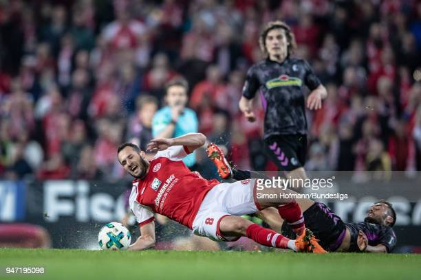 Levin Oeztunali of Mainz is fouled by Manuel Gulde of Freiburg during the Bundesliga match between 1 FSV Mainz 05 and SportClub Freiburg at Opel...