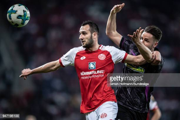 Levin Oeztunali of Mainz is tackled by Christian Guenter of Freiburg during the Bundesliga match between 1 FSV Mainz 05 and SportClub Freiburg at...