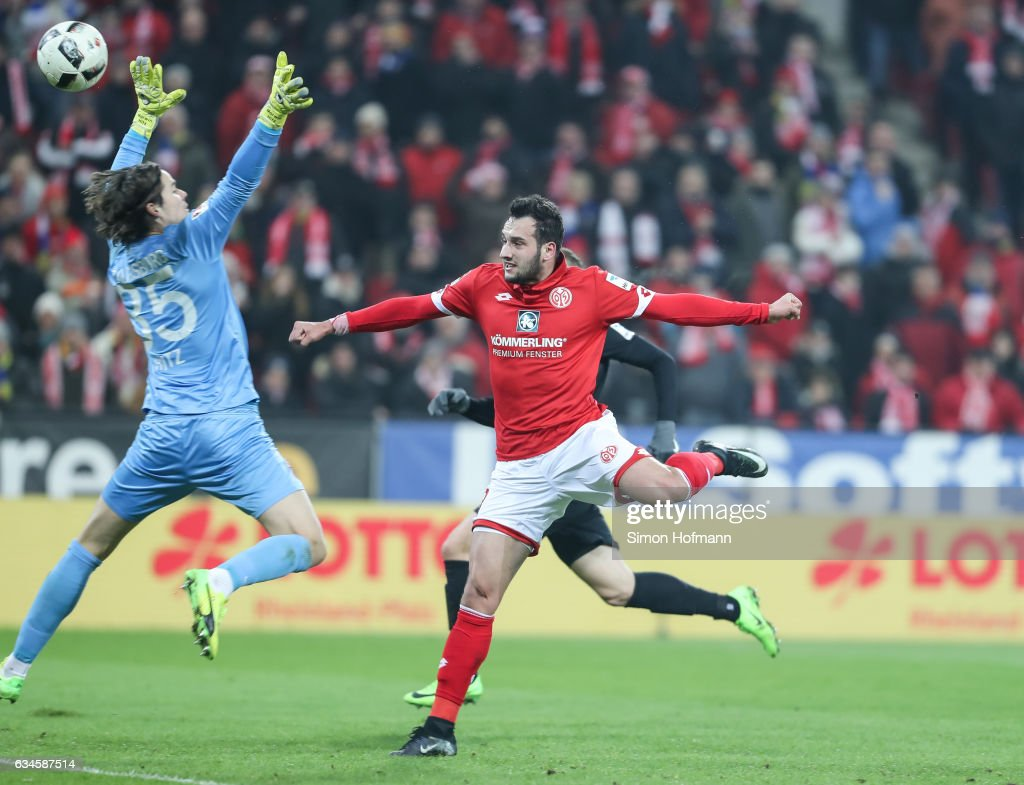 Levin Oeztunali of Mainz scores his team's first goal past Marwin Hitz of Augsburg during the Bundesliga match between 1. FSV Mainz 05 and FC Augsburg at Opel Arena on February 10, 2017 in Mainz, Germany.