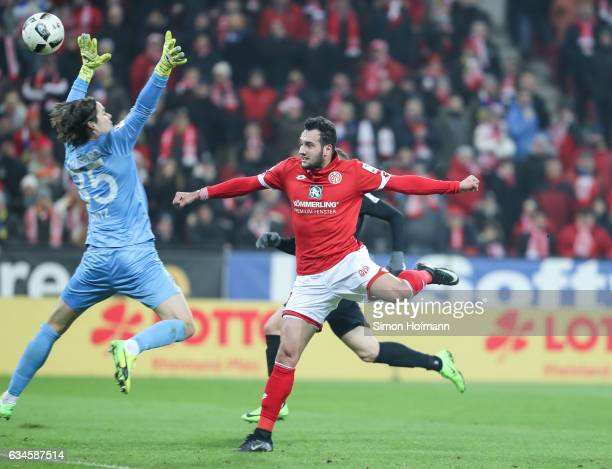 Levin Oeztunali of Mainz scores his team's first goal past Marwin Hitz of Augsburg during the Bundesliga match between 1 FSV Mainz 05 and FC Augsburg...