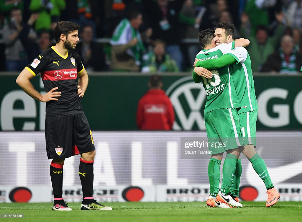 Levin Oeztunali of Werder Bremen (R) celebrates with Zlatko Junuzovic (16) as he scores their third goal during the Bundesliga match between Werder Bremen and VfB Stuttgart at Weserstadion on May 2, 2016 in Bremen, Germany.