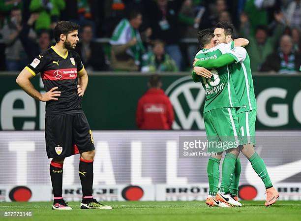 Levin Oeztunali of Werder Bremen celebrates with Zlatko Junuzovic as he scores their third goal during the Bundesliga match between Werder Bremen and...