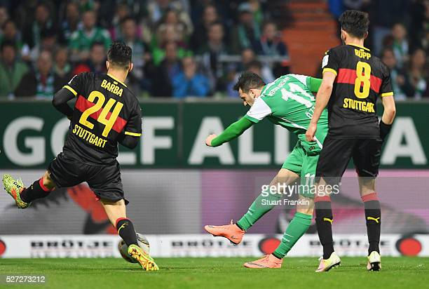 Levin Oeztunali of Werder Bremen shhots past Federico Barba of Stuttgart as he scores their third goal during the Bundesliga match between Werder...