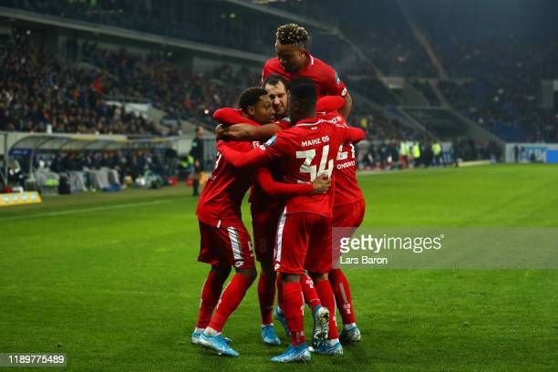 Levin Oztunali of 1. FSV Mainz 05 celebrates with team mates after scoring his team's first goal during the Bundesliga match between TSG 1899...